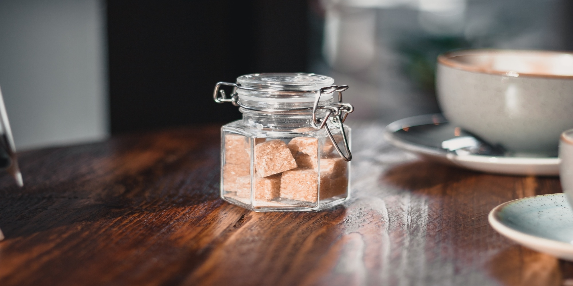 jar on taable with brown sugar cubes inside
