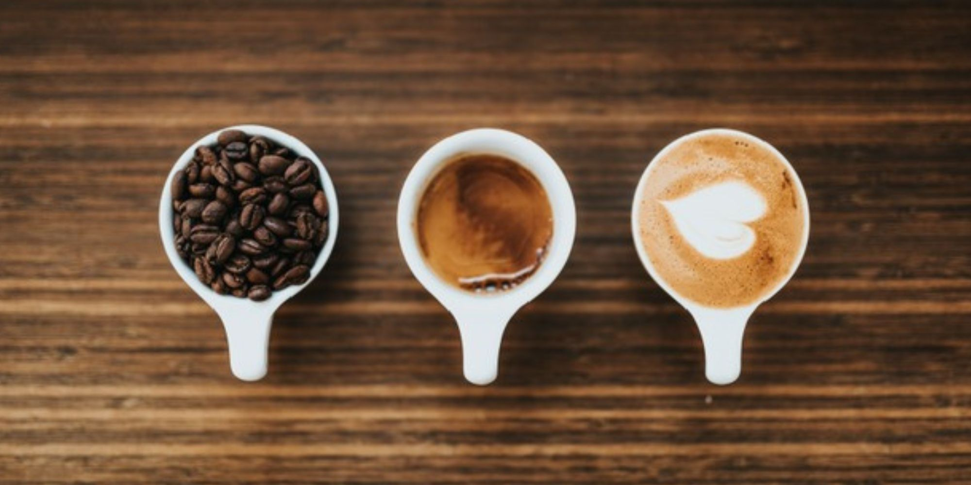 three white espresso cups filled with coffee