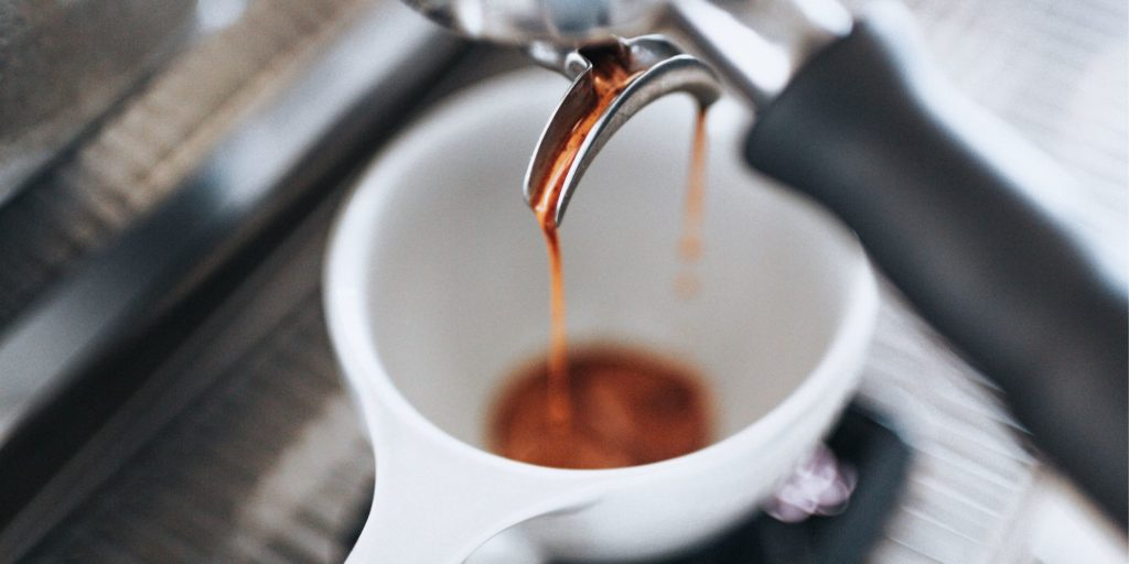 Coffee being extracted into a ristretto