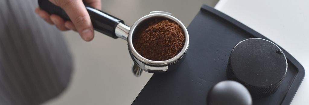 coffee grounds in porta- filter