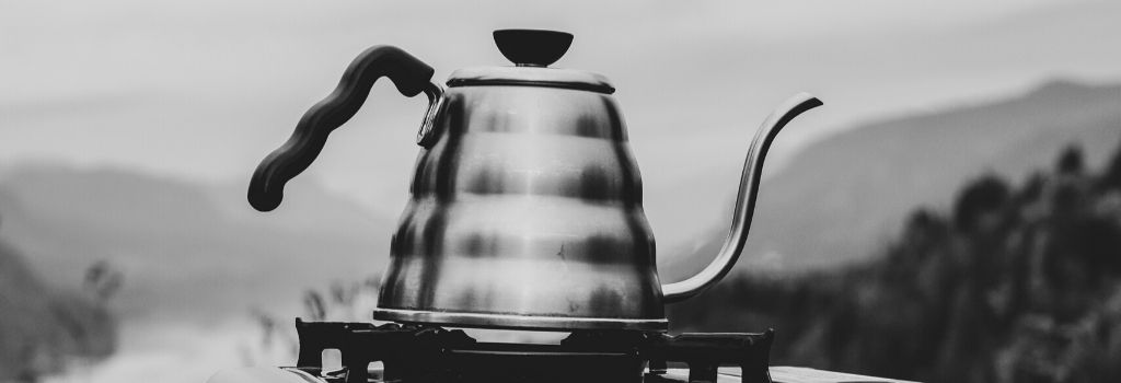 black and white image of gooseneck kettle on electric scales
