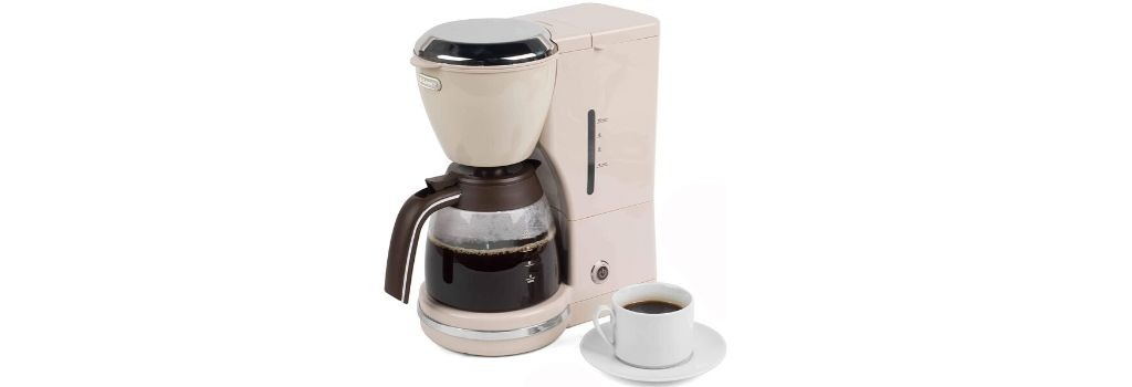 drip coffee machine with coffee in a cup sitting next to it