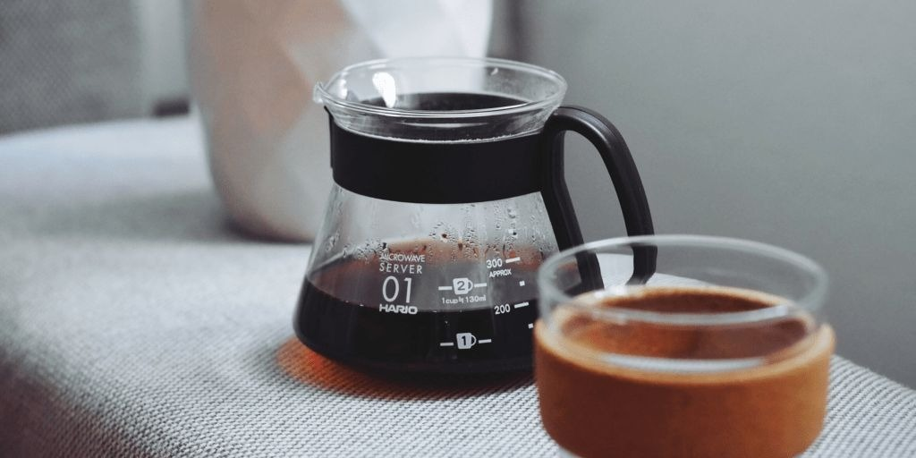 filtered black coffee next to a keep cup
