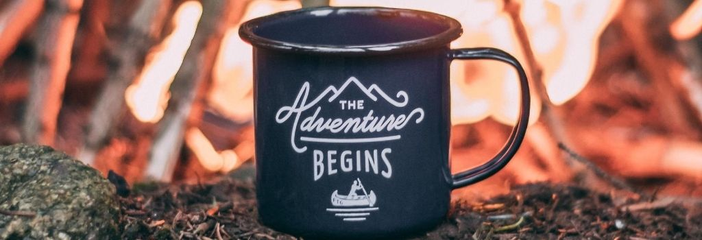 coffee mug in front of fire camping